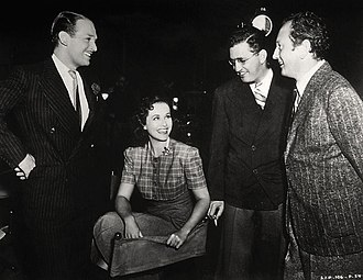 The Young in Heart - From left to right: Douglas Fairbanks Jr., Paulette Goddard, producer David O. Selznick, and director Richard Wallace