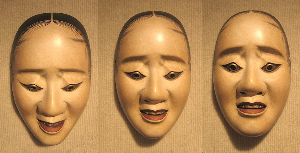 Three pictures of the same noh 'hawk mask' showing how the expression changes with a tilting of the head