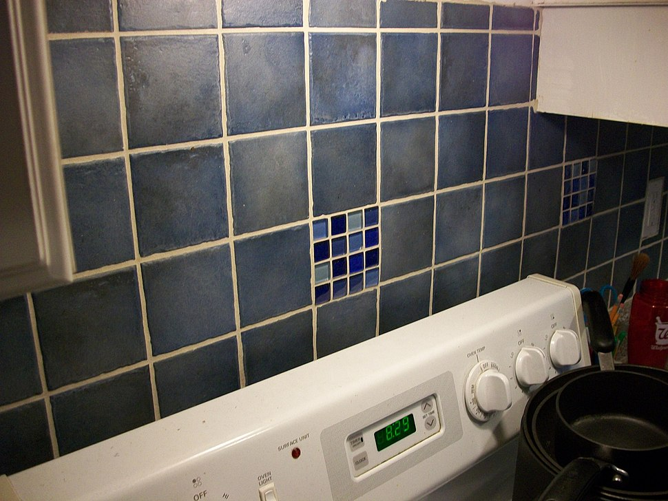 Tiling in kitchen above stove and countertop