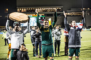 Liam Ridgewell - Ridgewell (right, wearing the British flag) celebrating the Timbers' victory over FC Dallas in the 2015 MLS Cup Playoffs.