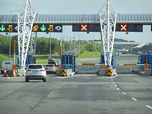 EFlow - The toll plaza on the M7 motorway with the eToll logo over the tollbooth showing that eFlow tags are accepted
