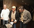 Tom P. Cusick JR, George Strait, and David Feherty with vet's Service Dog.jpg