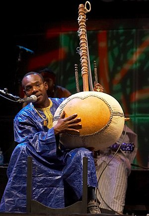 Toumani Diabaté - Toumani Diabaté describing the construction of the kora during a performance at Afrofest 2007 in Toronto, Ontario