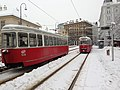 Trams at Volkstheater Stop Vienna winter (8500871754).jpg