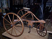 Three wheels on an antique tricycle.