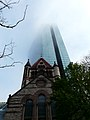 Trinity Church dwarf by The John Hancock Tower.JPG