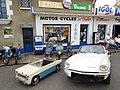 Triumph Spitfire and pedal car.jpg