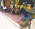 Two squatting women Thailand.jpg