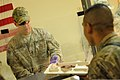 U.S. Army Command Sgt. Maj. Noe Salinas, left, the senior enlisted adviser for the 4th Brigade Combat Team, 10th Mountain Division, helps serve Thanksgiving dinner to Soldiers at Forward Operating Base Mehtar 131128-A-CB167-002.jpg