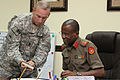U.S. Army Command Sgt. Maj. Ronnie R. Kelley, left, the senior enlisted adviser of U.S. Army Central Coalition Forces Land Component Command, shows fishing photos to Col. Abdul Salem, the commandant of 140827-A-DO086-901.jpg