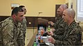 U.S. Marine Corps 1st Sgt. David Marbut, right, the company first sergeant of the Command Element, Black Sea Rotational Force 13, discusses aspects of Marine Corps leadership with a Georgian soldier during 130320-M-ZP546-050.jpg