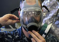 U.S. Navy Aviation Structural Mechanic 2nd Class Thomas Jenkins, assigned to amphibious assault ship USS Makin Island (LHD 8), checks the air seal on his respirator mask during chemical, biological 110113-N-ZS997-002.jpg