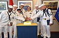 U.S. Navy Chief of Information Rear Adm. John Kirby, center, and honor graduates cut a cake following graduation May 24, 2013, at Recruit Training Command in Great Lakes, Ill 130524-N-BN978-006.jpg