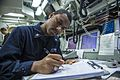 U.S. Navy Electrician's Mate 2nd Class Marquis Williams, assigned to the guided missile destroyer USS Mustin (DDG 89), stands watch inside the ship's engineering control center in the Pacific Ocean Sept 140922-N-TG831-073.jpg