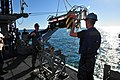 U.S. Navy Mineman (MN) Seaman Brett Walker, foreground, and MN2 Anthony Killen, middleground, assigned to MCM Crew Dominant and deployed aboard the mine countermeasures ship USS Gladiator (MCM 11), prepare to 130117-N-CG436-074.jpg
