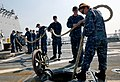 U.S. Sailors aboard the guided missile destroyer USS Momsen (DDG 92) stow mooring lines after getting underway in support of Cooperation Afloat Readiness and Training (CARAT) 2013 off the coast of Jakarta 130524-N-YU572-054.jpg