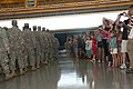 U.S. Soldiers with Detatchment 1, 150th Engineer Company, Delaware Army National Guard, bid farewell to friends and family members during their departure ceremony at Wilmington, Del., Aug. 11, 2013 130811-Z-GL773-040.jpg