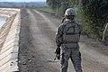 U.S. soldier provides security alongside a canal road near Saba al-Bor, Iraq (2008).jpg