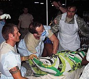 US Army soldiers deliver a baby in Haiti during Operation Unified Response