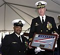 US Navy 030110-N-8837H-024 Command Master Chief Ronnie Moore presents Commander Kevin Sweeney, Commanding Officer, the Commissioning Pennant during his Change of Command.jpg
