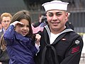 US Navy 030303-N-8273J-008 Sailor says goodbye to his daughter before deploying with USS Nimitz battle group.jpg