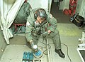 US Navy 030816-N-1928O-036 Ordnanceman 1st Class Mark Mainland, of Racine, Wis., loads an under-water signaling device into an ejection chute of a P-3C Orion.jpg