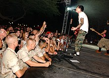 US Navy 030825-N-6803B-001 The rock band Blink-182 guitarist and singer Tom Delonge performs for Sailors and Marines at Naval Support Activity Bahrain's Main Street Park.jpg