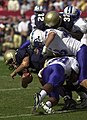 US Navy 031004-N-6157F-013 Navy senior quarterback Craig Candeto is tackled by Air Force free safety Larry Duncan and linebacker John Rudzinski.jpg
