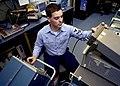 US Navy 040331-N-9630B-017 Aviation Electronics Technician 2nd Class Michael Cote, of Opelousas, La., troubleshoots electronic equipment in the Aviation Intermediate Maintenance Department (AIMD) aboard USS George Washington (C.jpg