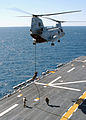 US Navy 040405-N-2651J-005 U.S. Marines assigned to the 24th Marine Expeditionary Unit (MEU) fast rope from a CH-46 Sea Knight to the flight deck of the amphibious assault ship USS Saipan (LHA 2).jpg