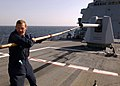 US Navy 050207-N-5345W-036 Gunner's Mate 3rd Class Robert Jackson pulls a gun swab out of the turret of the MK-45 5-in.-54-cal. lightweight gun.jpg