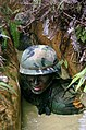 US Navy 050225-N-9712C-005 Builder 3rd Class Marcos Lopez, a Seabee assigned to Naval Mobile Construction Battalion Four Zero (NMCB-40), low-crawls through a trench during the endurance course at the Jungle Warfare Training Cen.jpg