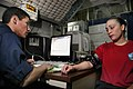 US Navy 050629-N-3136P-008 Hospitalman Apprentice Aaron Zuniga monitors a Sailor's vital signs.jpg