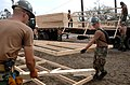 US Navy 050924-N-2653P-057 U.S. Navy Seabees, assigned to Naval Mobile Construction Battalion Four (NMCB-4), help assemble the foundation for the first of 75 temporary housing shelters in Pass Christian, Miss.jpg