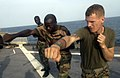 US Navy 051103-F-5789F-023 U.S. Marine Corps Lance Cpl. Chuck Myers, assigned to 2nd Platoon, Charlie Company, 1st Battalion, 8th Marines, trains a Senegalese Navy infantryman in Marine Corps Martial Arts.jpg