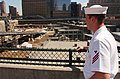 US Navy 060525-N-4936C-002 Machinist's Mate Fireman Kyle Martindale looks out over the New York World Trade Center Ground Zero site.jpg