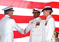 US Navy 061120-N-4399G-082 Vice Adm. William D. Crowder shakes the hand of Rear Adm. Victor G. Guillory after he was relieved of his duties by Rear Adm. Carol M. Pottenger on board dock landing ship USS Harpers Ferry (LSD 49).jpg