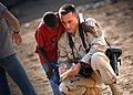 US Navy 061212-N-1328C-150 U.S. Air Force Master Sgt. Scott Wagers, from Atlanta, Ga., writes down the name of an orphan at a boy's orphanage while photographing service members from Camp Lemonier and Combined Joint Task Force.jpg
