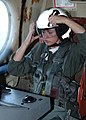 US Navy 070213-N-1810F-087 Cryptologic Technician Seaman Shelbie Cain assigned to Patrol Squadron Three Zero (VP-30) dons her helmet for an immediate ditch drill during a training flight.jpg