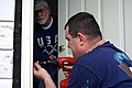 US Navy 070301-N-9688S-005 Aviation Support Equipment Technician 1st Class David Hawkingberry installs a lock on the front door of a New Orleans area home damaged during Hurricane Katrina.jpg