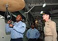 US Navy 070417-N-6710M-031 Information System Technician 3rd Class Anthony Seay demonstrates the proper way to hit a speed bag.jpg