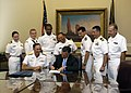 US Navy 070912-N-5208T-003 Utah Gov. Jon M. Huntsman Jr., foreground right, presents Rear Adm. Scott R. Van Buskirk, commander of Carrier Strike Group 9, an official declaration proclaiming Sept. 6-16 Utah Navy Week.jpg