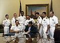 US Navy 070912-N-5208T-003 Utah Gov. Jon M. Huntsman Jr., foreground right, presents Rear Adm. Scott R. Van Buskirk, commander of Carrier Strike Group 9, an official declaration proclaiming Sept. 6-16 Utah Navy Week.jpg