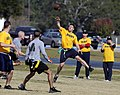 US Navy 071201-N-5328N-589 Quarterback and Cryptologic Technician (Technical) 1st Class Jakob Chauvin passes the ball during the fifth annual CID Corry Station Flag Football Game at Corry Station.jpg