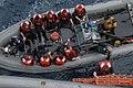 US Navy 080605-N-8613A-036 Midshipmen embarked aboard the amphibious dock landing ship USS Ashland (LSD 48) board a small boat after learning boat deck fundamentals.jpg