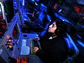 US Navy 080813-N-7981E-176 Operations Specialist Seaman Michelle Villabrille, from Pasadena, Calif., manages air contacts from a console in the display and tracking module of the Combat Direction Center aboard the aircraft carr.jpg