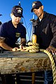 US Navy 080820-N-0167W-067 Seaman Ryan Ellis teaches Master-at-Arms 1st Class Jonathan Ramirez how to properly knot a ship's line.jpg