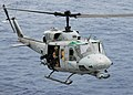 US Navy 081017-N-2183K-014 A UH-1N Twin Huey helicopter gunship approaches the flight deck of the amphibious assault ship USS Peleliu (LHA 5).jpg
