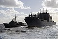 US Navy 090718-N-9123L-188 Royal Australian Navy guided-missile frigate HMAS Darwin (FFG 04) conducts an underway replenishment with the Military Sealift Command dry cargo-ammunition ship USNS Amelia Earhart (T-AKE 6).jpg