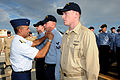 US Navy 091204-N-1906L-003 Rear Adm. Manson Brown presents special operations ribbons to Chief Electronics Technician Calvin Williams, Boatswain's Mate 2nd Class Chris Nuemann, and Operations Specialist 3rd Class Seth Miller.jpg